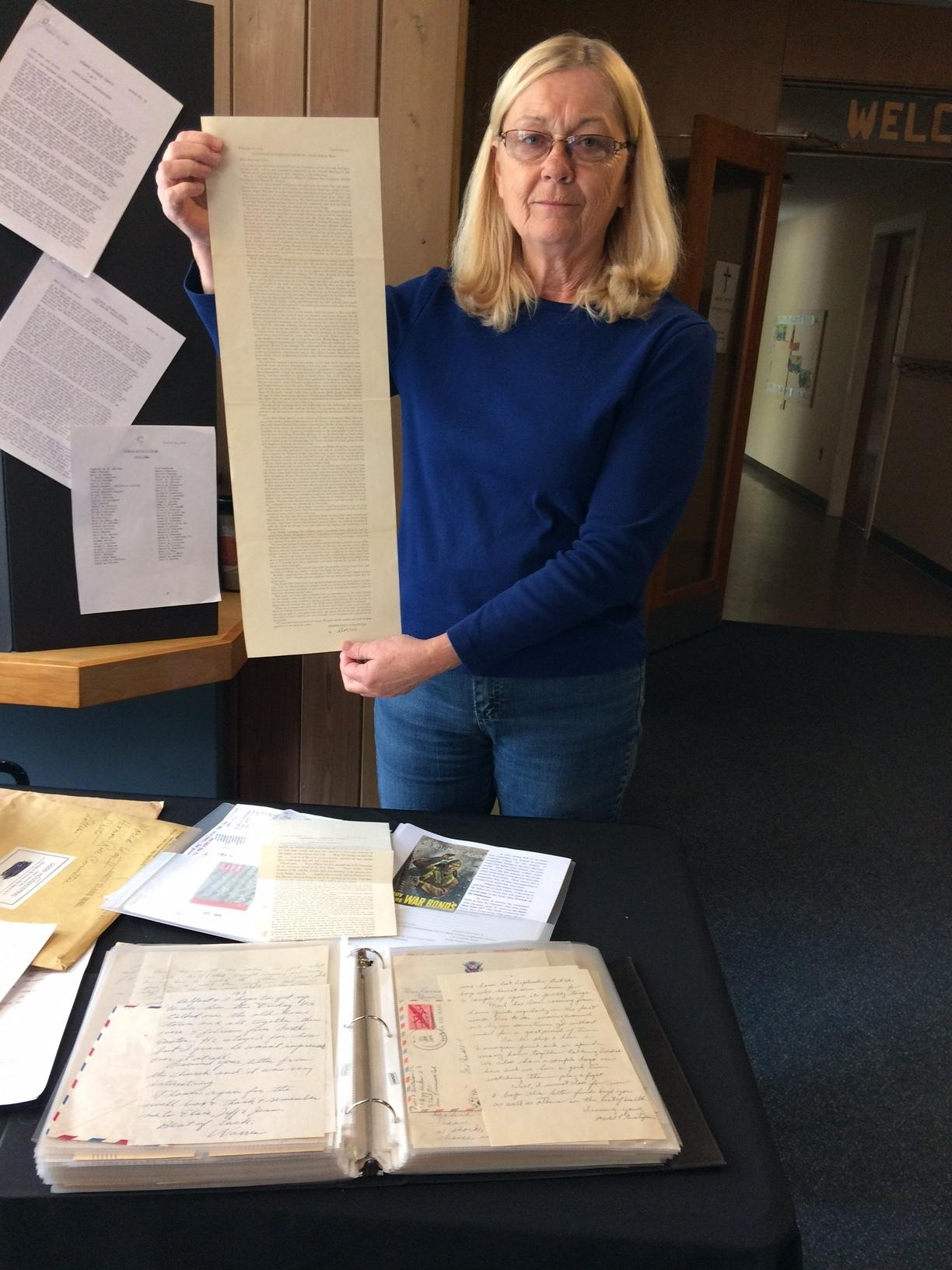 Elaine Sears shows archival material held by Holy Trinity.